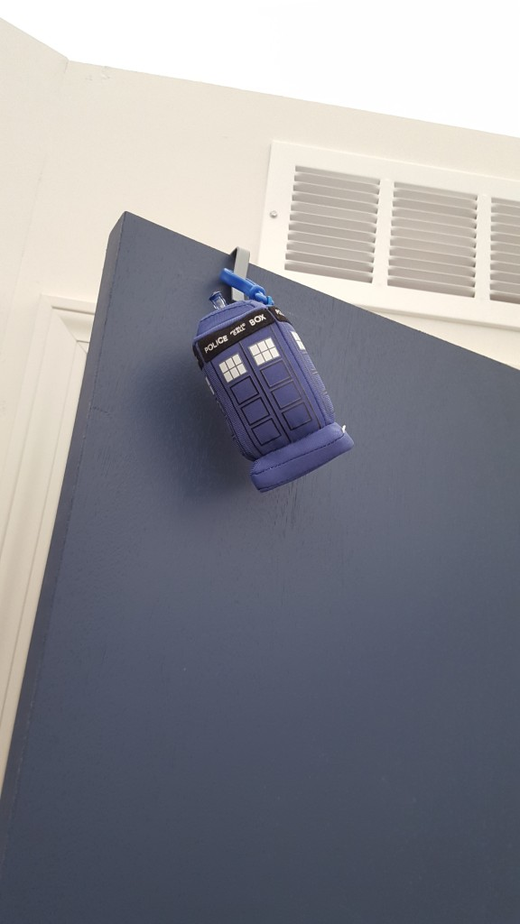"I don't really have an excuse for this one, I'm just immensely pleased that I have a plush TARDIS hanging on my door. When you squeeze it it goes ""Vwoorp vwoorp vwoorp!"" and fades into another time and space. Or just the noises."