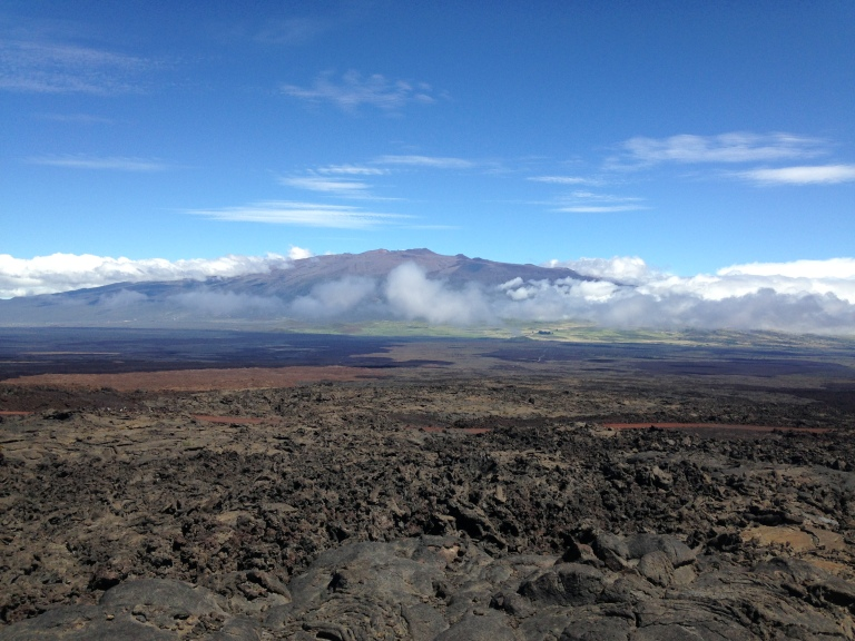 Mauna Kea is looking mighty fine today! We're often just sitting in a blank nothing, clouds often envelope the habitat. But when you get out and it's a clear day, man...you can see forever! Can you spot the teeny tiny telescopes on top of the mountain?