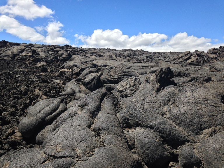 Pahoehoe on the right, yes, gooood lava, you're nice. A'a lava on the left, that's bad lava, it crumbles and cuts and is mean. We hates it, don't we precious?