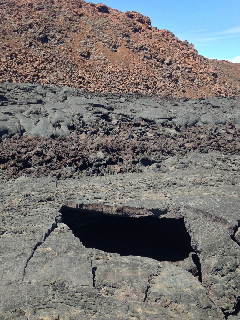 Oh man, the collapsed wall of a little lava tube! Neat-o! These things are so cool because they can be surprisingly thing, out of rock that's not that strong really. But the geometry of the stone will easily support huge amounts of weight. Natural structure!