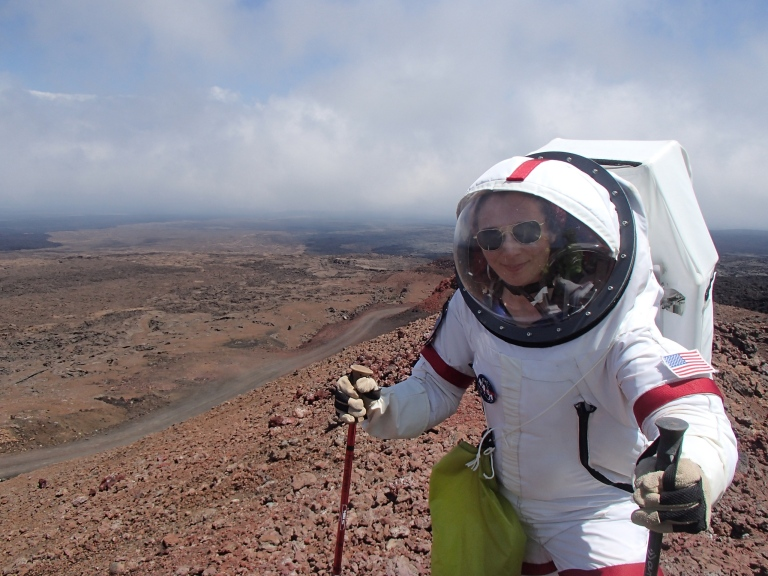 Shey has successfully made it up the ridge! While her MX-C suit is much heavier than ours, having a battery and all sorts of stuff mounted in that backpack, she's also got a liquid cooled vest on full of ice water. She is, by far, the most comfortable person out there.
