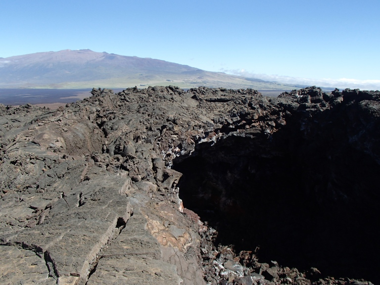 This is a good shot showing not only the size of this giant hole, but look...it's like five times bigger than Mauna Kea! And yeah yeah go on about forced perspective and such all you want, you KNOW the moon is only the size of a quarter, go hold one up against it tonight, you'll see!